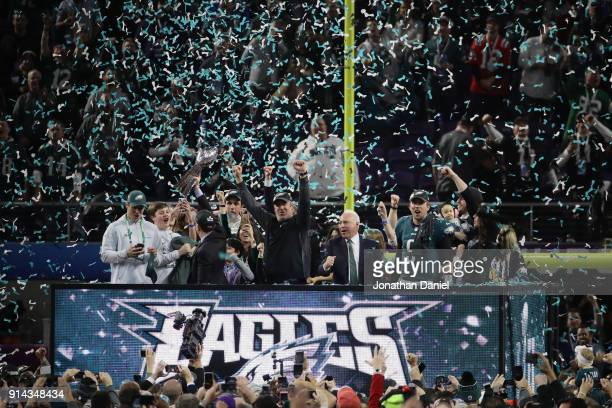 Head coach Doug Pederson owner Jeffrey Lurie and Nick Foles of the Philadelphia Eagles celebrate with the Vince Lombardi Trophy after the Eagles...