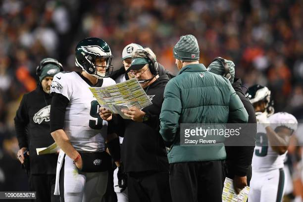 Head coach Doug Pederson talks to Nick Foles of the Philadelphia Eagles against the Chicago Bears in the fourth quarter of the NFC Wild Card Playoff...