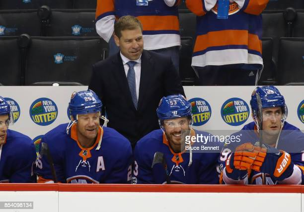 Head coach Doug Weight of the New York Islanders handles bench duties against the New Jersey Devils during a preseason game at the Barclays Center on...