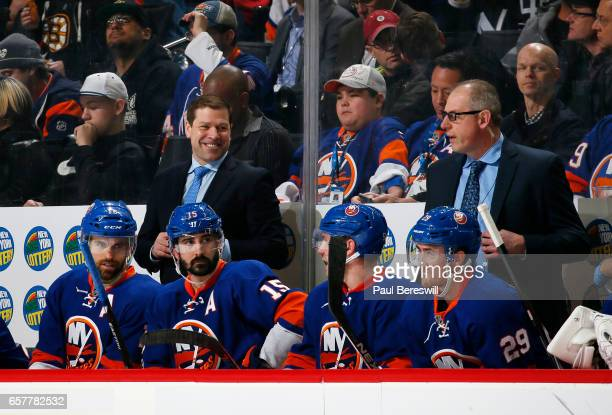 Head coach Doug Weight of the New York Islanders looks on from the bench as he waits for the decision of the goal review during the first period...