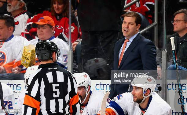 Head coach Doug Weight of the New York Islanders talks with referee Chris Rooney during the game against the New Jersey Devils at Prudential Center...
