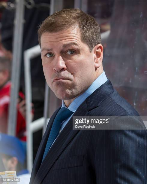 Head coach Doug Weight of the New York Islanders watches the action from the bench during an NHL game against the Detroit Red Wings at Joe Louis...