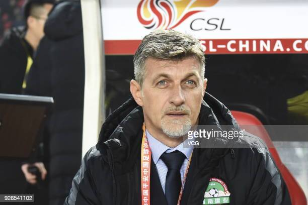 Head coach Dragan Talajic of Henan Jianye looks on during the 2018 Chinese Football Association Super League first round match between Henan Jianye...