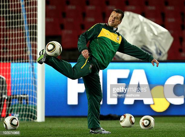 Head Coach Dunga controls the ball during the Brazil training session at Ellis Park on June 14 2010 in Johannesburg South Africa Brazil will play...