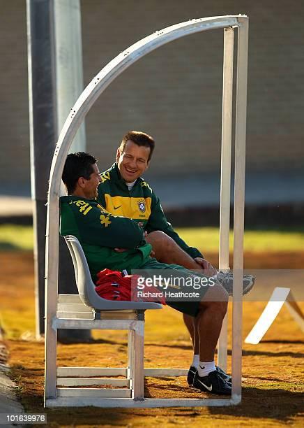 Head Coach Dunga talks with his assitant Jorginho during the Brazil training session at Randburg High School on June 5, 2010 in Johannesburg, South...