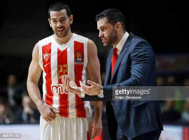 Head coach Dusan Alimpijevic talks to Taylor Rochestie of Crvena Zvezda during the 2017/2018 Turkish Airlines EuroLeague Regular Season Round 18 game...