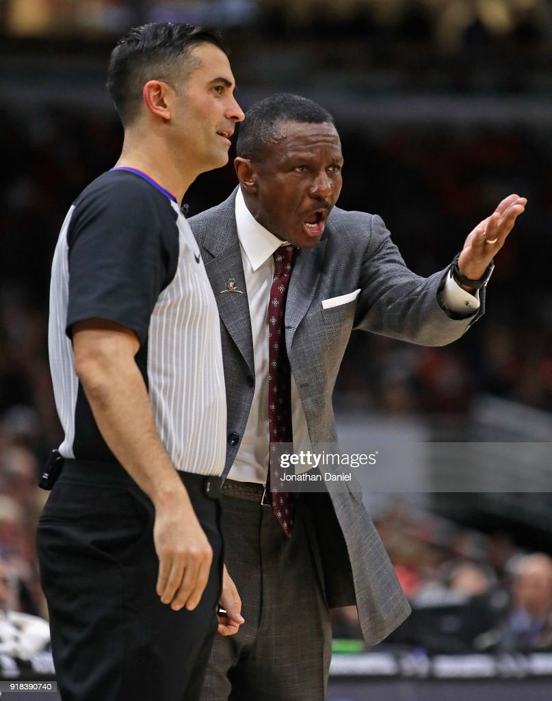 Head coach Dwane Casey argues with referee Zach Zarba #15 during a game against the Chicago Bulls at the United Center on February 14, 2018 in Chicago, Illinois. The Raptors defeated the Bulls 122-98.