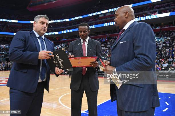Head Coach Dwane Casey of the Detroit Pistons draws up a play during Game Four of Round One of the 2019 NBA Playoffs against the Milwaukee Bucks on...