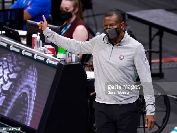 Head coach Dwane Casey of the Detroit Pistons huddles directs his team during their game against the Charlotte Hornets at Spectrum Center on May 01,...