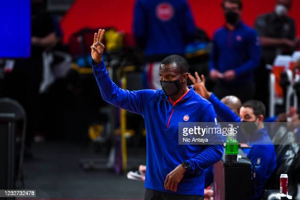 Head coach Dwane Casey of the Detroit Pistons signals during the first quarter against the Memphis Grizzlies at Little Caesars Arena on May 06, 2021...
