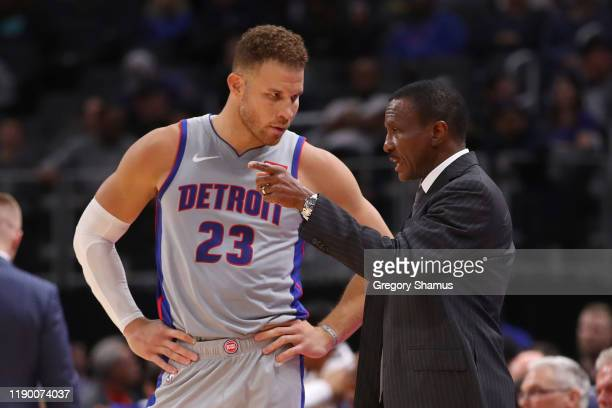 Head coach Dwane Casey of the Detroit Pistons talks to Blake Griffin in the second half while playing the Orlando Magic at Little Caesars Arena on...