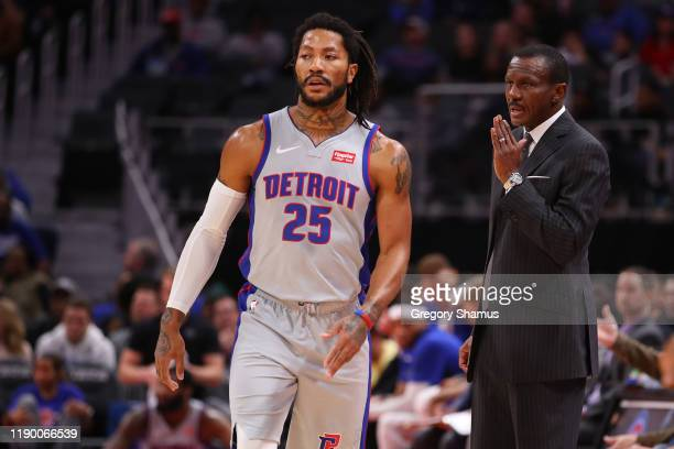 Head coach Dwane Casey of the Detroit Pistons talks to Derrick Rose in the first half while playing the Orlando Magic at Little Caesars Arena on...