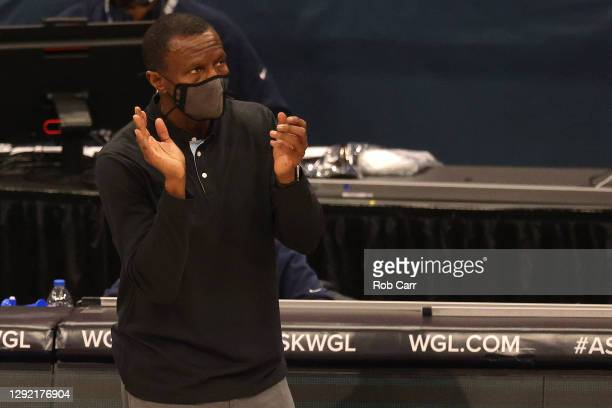 Head coach Dwane Casey of the Detroit Pistons watches play against the Washington Wizards during the second half of a preseason game at Capital One...