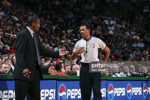 Head coach Dwane Casey of the Minnesota Timberwolves talks with NBA official Eric Lewis during a game against the Milwaukee Bucks at the Bradley...