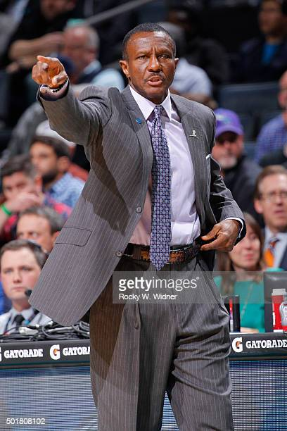 Head Coach Dwane Casey of the Toronto Raptors coaches against the Charlotte Hornets on December 17 2015 at Time Warner Cable Arena in Charlotte North...