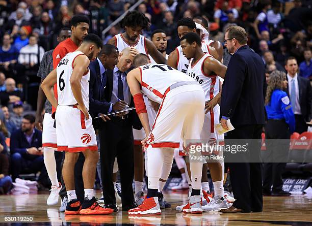 Head Coach Dwane Casey of the Toronto Raptors draws on a white board during the second half of an NBA game at Air Canada Centre on December 16 2016...