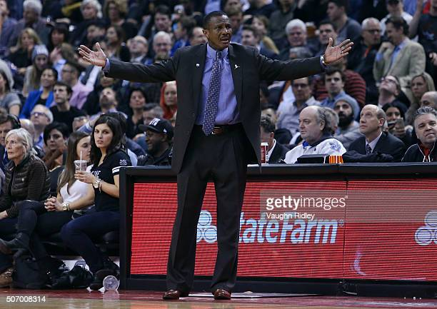 Head Coach Dwane Casey of the Toronto Raptors gestures to the referee during an NBA game against the Washington Wizards at the Air Canada Centre on...