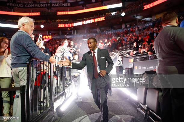 Head coach Dwane Casey of the Toronto Raptors gets introduced before the game against the Chicago Bulls on October 19 2017 at the Air Canada Centre...