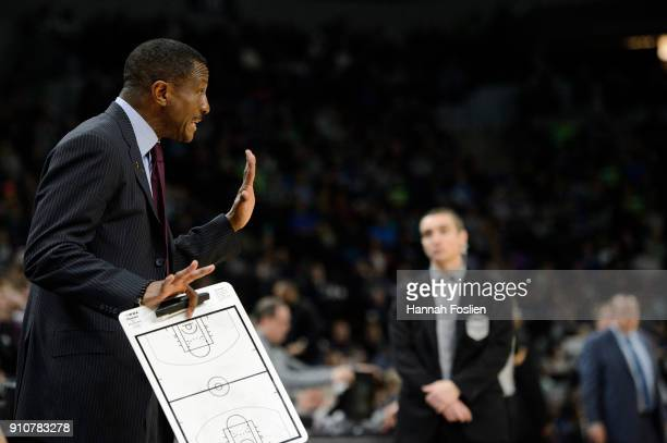 Head coach Dwane Casey of the Toronto Raptors looks on during the game against the Minnesota Timberwolves on January 20 2018 at the Target Center in...