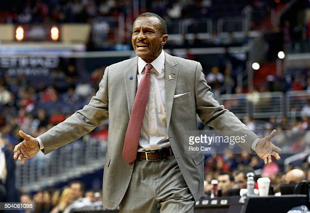 Head coach Dwane Casey of the Toronto Raptors looks on in the first half against the Washington Wizards at Verizon Center on January 8 2016 in...