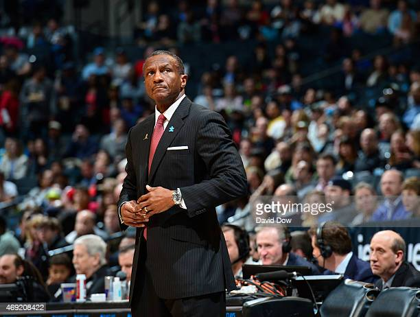 Head Coach Dwane Casey of the Toronto Raptors looks on while wearing his Autism Awareness Pin against the Brooklyn Nets at Barclays Center on April...