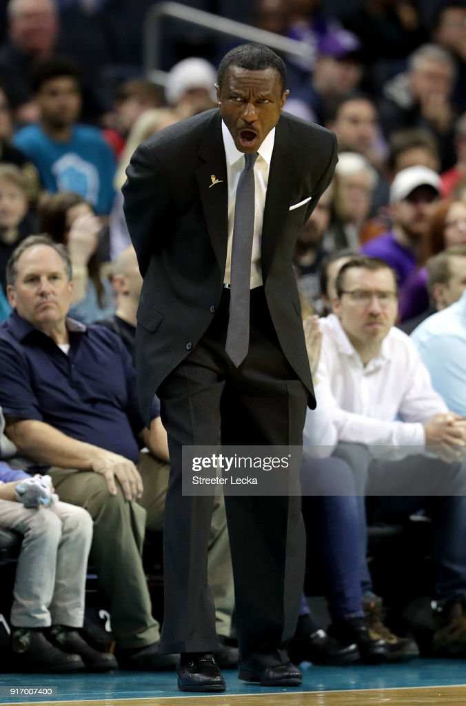 Head coach Dwane Casey of the Toronto Raptors reacts against the Charlotte Hornets during their game at Spectrum Center on February 11, 2018 in Charlotte, North Carolina.