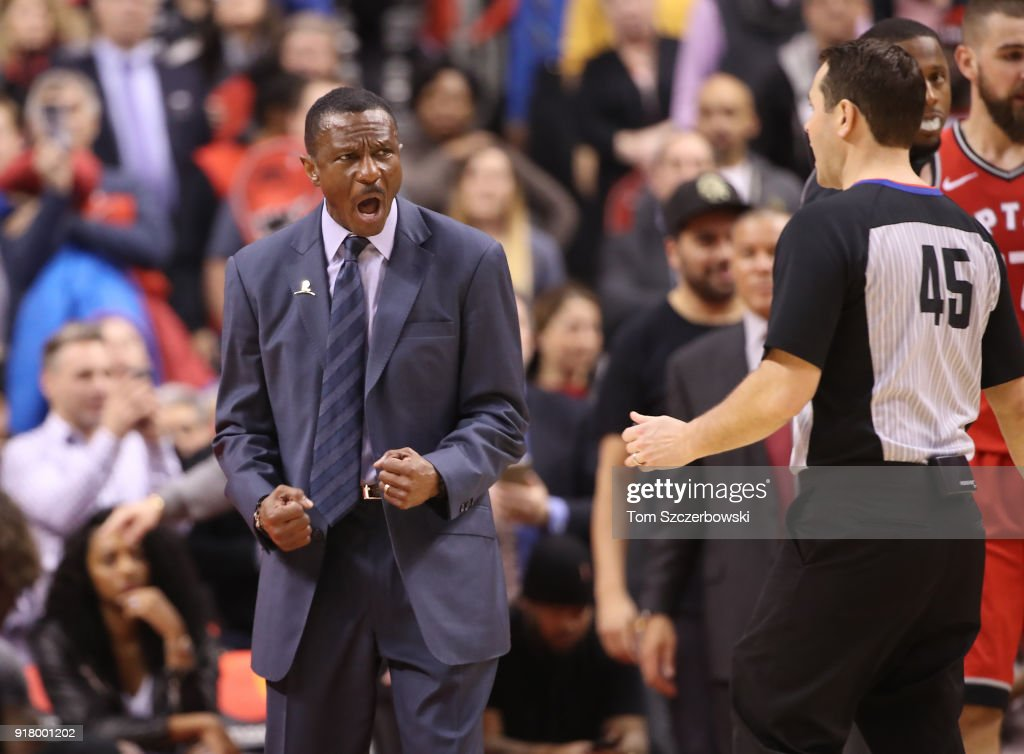 Head coach Dwane Casey of the Toronto Raptors reacts to a call by referee Brian Forte #45 against the Miami Heat at Air Canada Centre on February 13, 2018 in Toronto, Canada.