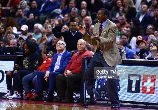 Head Coach Dwane Casey of the Toronto Raptors shouts from the sidelines during the second half of an NBA game against the Miami Heat at Air Canada...