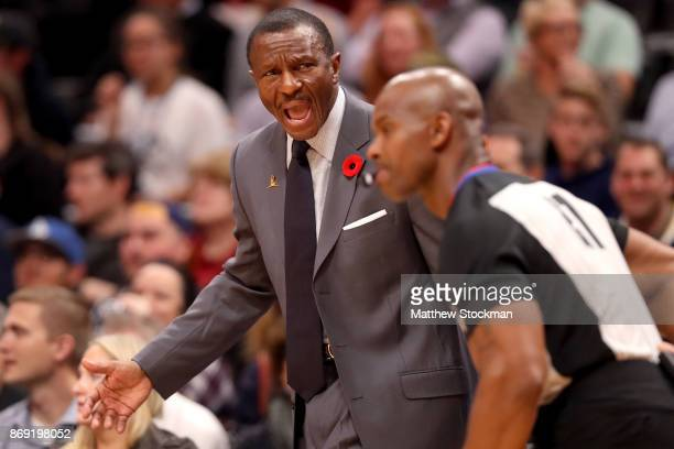 Head coach Dwane Casey of the Toronto Raptors shouts instructions to his team as they play the Denver Nuggets at the Pepsi Center on November 1 2017...