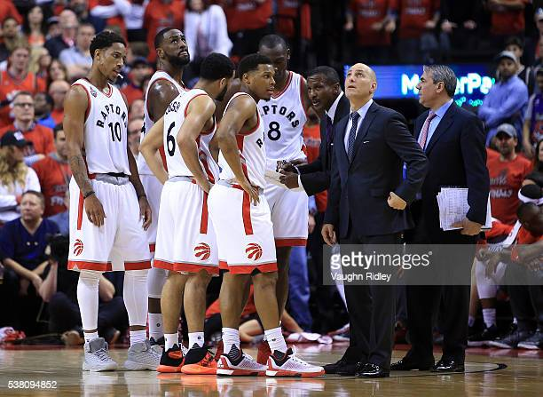 Head Coach Dwane Casey of the Toronto Raptors speaks to his players in the second half of Game Three of the Eastern Conference Finals against the...