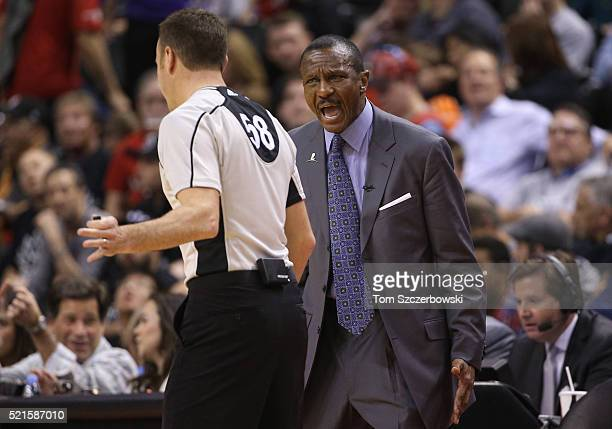 Head coach Dwane Casey of the Toronto Raptors takes issue with a call to NBA official Josh Tiven against the Indiana Pacers in Game One of the...