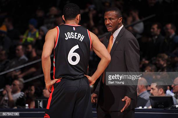 Head Coach Dwane Casey of the Toronto Raptors talks to Cory Joseph of the Toronto Raptors during the game against the Denver Nuggets on February 1...