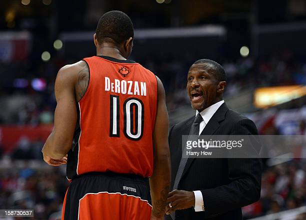 Head Coach Dwane Casey of the Toronto Raptors talks with DeMar DeRozan during a 102-83 Los Angeles Clipper win at Staples Center on December 9, 2012...
