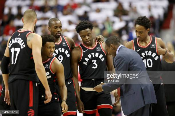 Head coach Dwane Casey of the Toronto Raptors talks with his team in the first half against the Washington Wizards during Game Three of Round One of...