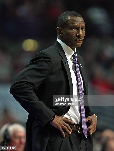 Head coach Dwane Casey of the Toronto Raptors watches as his team takes on the Chicago Bulls at the United Center on December 28 2015 in Chicago...