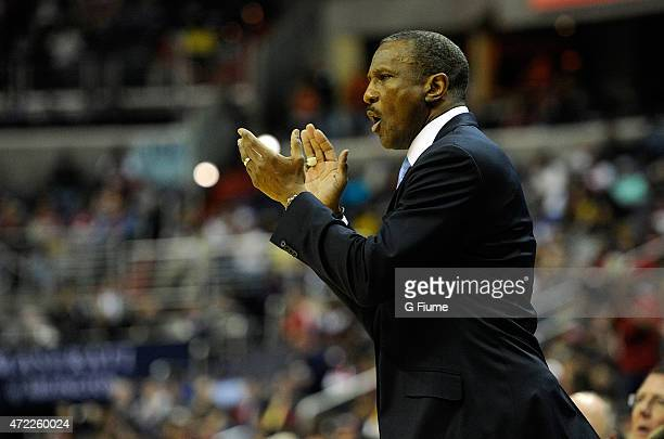 Head Coach Dwane Casey of the Toronto Raptors watches the game against the Washington Wizards during Game Four of the Eastern Conference...