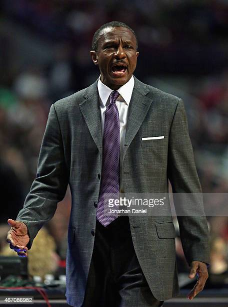 Head coach Dwane Casey of the Toronto Raptors yells instructions to his team against the Chicago Bulls at the United Center on March 20 2015 in...