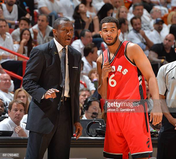 Head Coach Dwane Casey speaks with Cory Joseph of the Toronto Raptors against the Miami Heat during the Eastern Conference playoffs Semifinals Game...