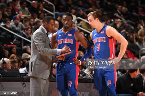 Head Coach Dwane Casey talks to Reggie Jackson and Luke Kennard of the Detroit Pistons during a game against the Milwaukee Bucks on January 29, 2019...