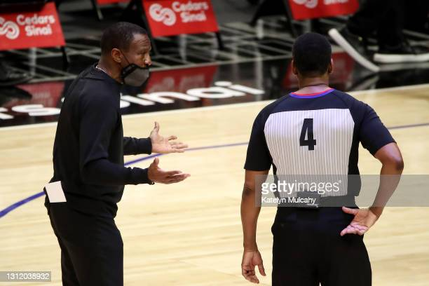 Head coach Dwayne Casey of the Detroit Pistons reacts to a play with referee Sean Wright during the second quarter against the Los Angeles Clippers...