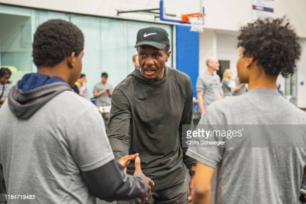 Head Coach Dwayne Casey of the Detroit Pistons takes part in a thanksgiving event at Detroit Pistons Performance Center on November 18, 2019 in...