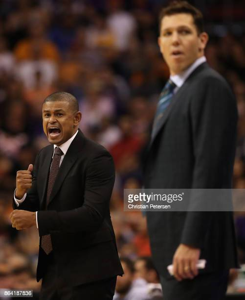 Head coach Earl Watson of the Phoenix Suns reacts alongside Luke Walton of the Los Angeles Lakers during the first half of the NBA game at Talking...