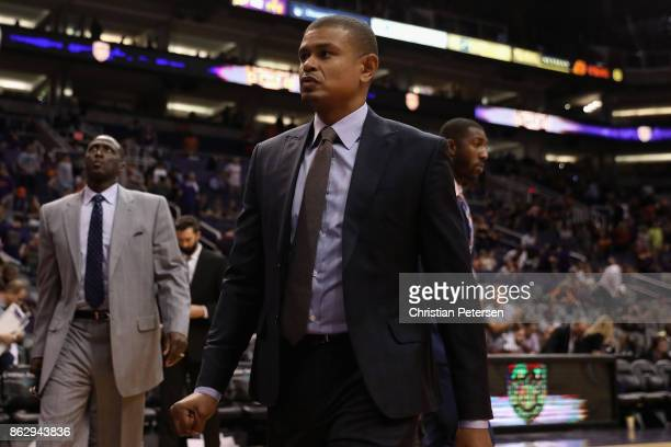 Head coach Earl Watson of the Phoenix Suns reacts as he walks off the court following the NBA game against the Portland Trail Blazers at Talking...
