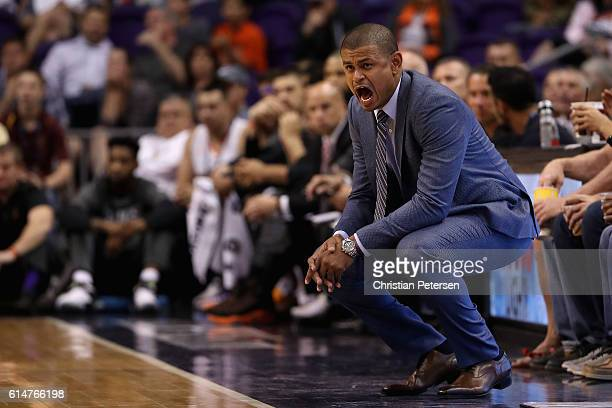 Head coach Earl Watson of the Phoenix Suns reacts during the first half of the preseason NBA game against the Dallas Mavericks at Talking Stick...