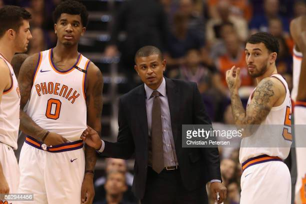 Head coach Earl Watson of the Phoenix Suns talks with Marquese Chriss and Mike James during the second half of the NBA game against the Portland...