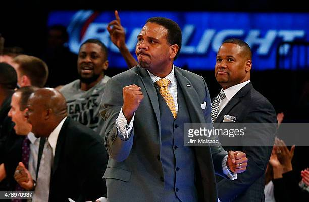 Head coach Ed Cooley of the Providence Friars celebrates in the first half against the Creighton Bluejays during the Championship game of the 2014...