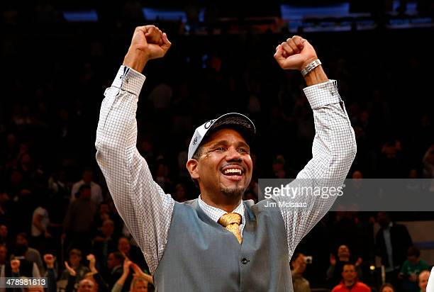 Head coach Ed Cooley of the Providence Friars celebrates their 65 to 58 win over the Creighton Bluejays during the Championship game of the 2014...