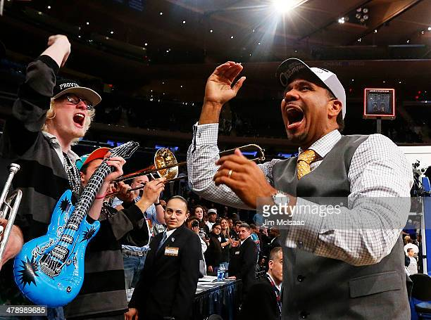 Head coach Ed Cooley of the Providence Friars celebrates their 65 to 58 win over the Creighton Bluejays after the Championship game of the 2014 Men's...