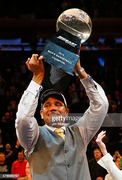 Head coach Ed Cooley of the Providence Friars celebrates with the trophy after their 65 to 58 win over the Creighton Bluejays during the Championship...