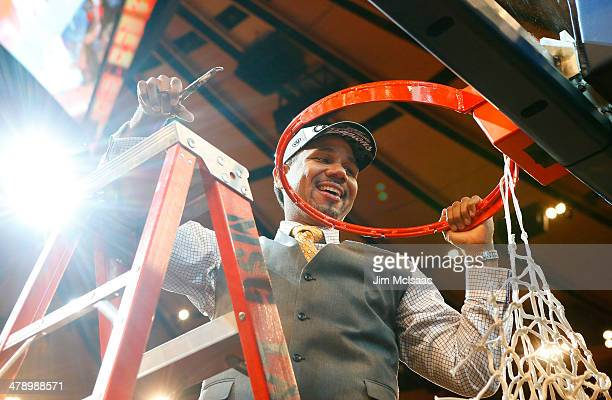 Head coach Ed Cooley of the Providence Friars cuts down the net as he celebrates their 65 to 58 win over the Creighton Bluejays during the...